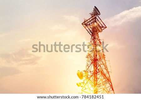 Abstract telecommunication tower Antenna and satellite dish at sunset sky background Royalty-Free Stock Photo #784182451