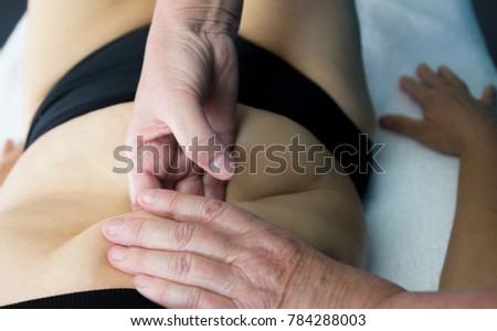 Woman having deep tissue massage #784288003
