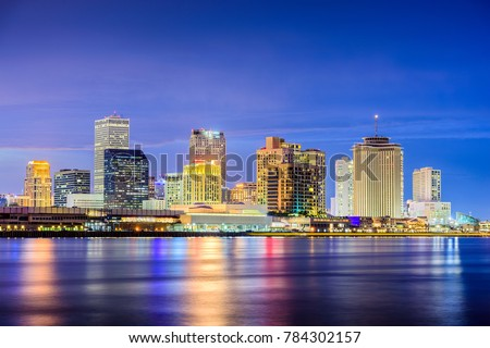 New Orleans, Louisiana, USA night skyline on the Mississippi River.