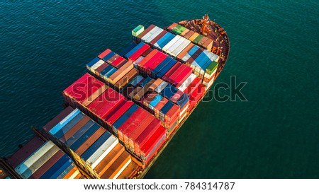 Logistic and transportation of International container cargo ship in the open sea, Top view of cargo ship. #784314787