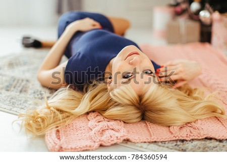 Girl lying on the floor near one tree #784360594
