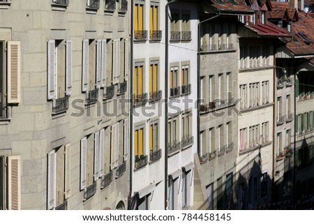Bern, Switzerland - September 25, 2017: The front walls of Old Town buildings. These tenement houses and many others with their magnificent architecture encourage tourists to visit this wonderful city #784458145