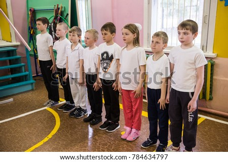 Leningrad region, Russia - May 12, 2017: Schoolchildren of the junior class of rural schools stand in the ranks in physical education classes. #784634797