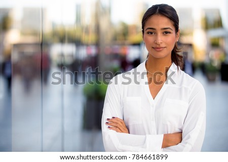 Headshot portrait of a beautiful multiethnic female business professional at work office building #784661899