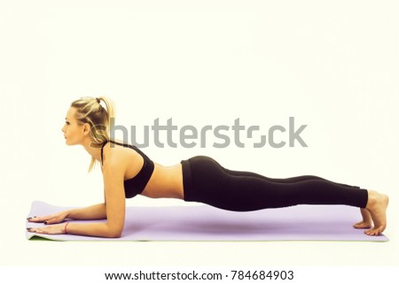 Pretty girl or sporty woman, fit athlete, with sexy, muscular torso, body, wearing black sportswear, bra, exercising on grey yoga mat isolated on white background. Fitness and healthy lifestyle #784684903