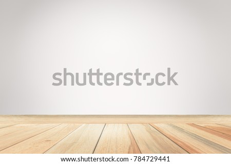 Empty gray wall room interior free space background with blurry soft light and brown wood flat floor perspectives,well can be used for montage or display your products and use text on background. #784729441