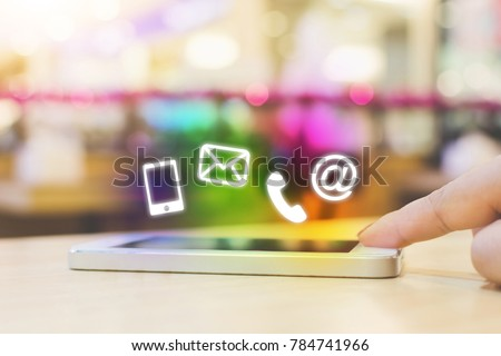 Woman hand pushing button smartphone, Business connection contact us and call center customer service concept, Icon mobile phone, email envelope, telephone and e-mail address #784741966