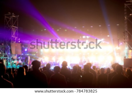 Blurred background : Bokeh lighting in outdoor concert with cheering audience #784783825