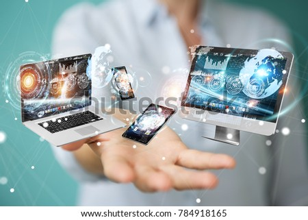 Tech devices connected to each other by businesswoman on blurred background 3D rendering #784918165
