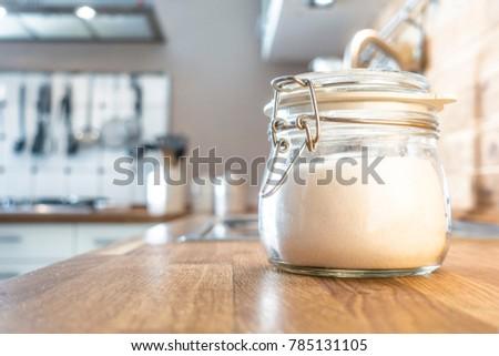 Sugar on a wooden kitchen #785131105