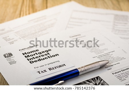 Tax reform concept with tax preparation forms for standardized deductions and mortgage interest deductions  #785142376