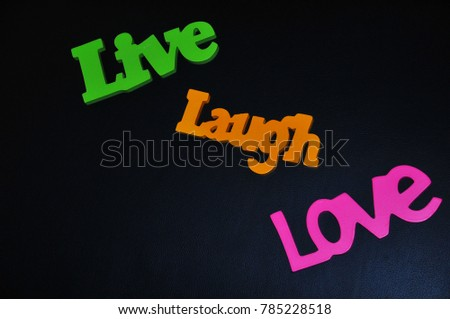 Inspirational words of happy life arranged on a black background