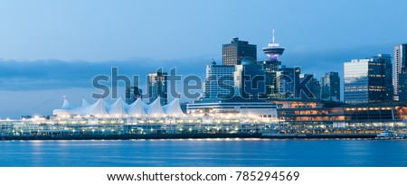 View of downtown Vancouver with Canada Place and Vancouver Lookout during sunrise blue hour