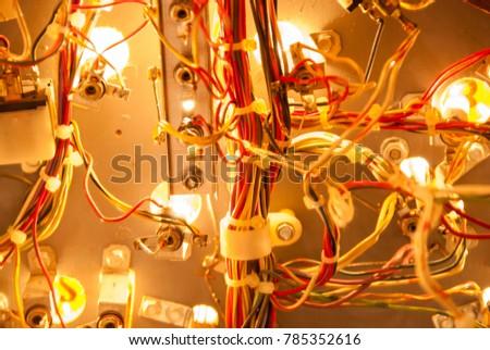 Wiring and lights inside pinball machine Royalty-Free Stock Photo #785352616