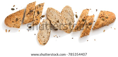 Top view of bread with different seeds ( pumpkin,  poppy, flax, sunflower, sesame,  millet ) decorated with wheat ears isolated on white background. #785354407