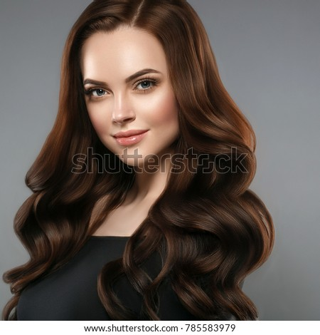 Woman beauty healthy skin and hairstyle, brunette with long hair over dark background female portrait. Studio shot. #785583979