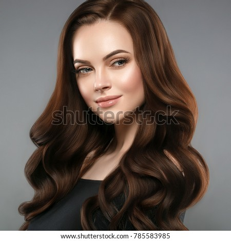 Woman beauty healthy skin and hairstyle, brunette with long hair over dark background female portrait. Studio shot. #785583985