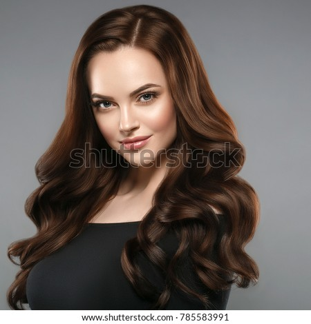 Woman beauty healthy skin and hairstyle, brunette with long hair over dark background female portrait. Studio shot. #785583991