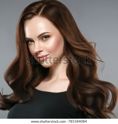 Woman beauty healthy skin and hairstyle, brunette with long hair over dark background female portrait. Studio shot. #785584084