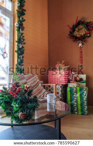 decorated home interior with xmas gifts in  cottage.  #785590627