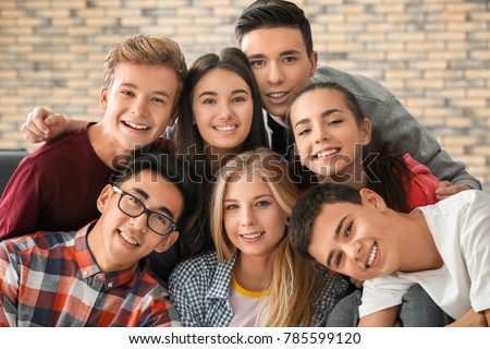Group of funny teenagers indoors #785599120