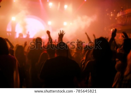 Effects blur Concert, disco dj party. People with hands up having fun #785645821
