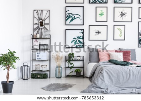 Beautiful nature posters in a white bedroom interior #785653312