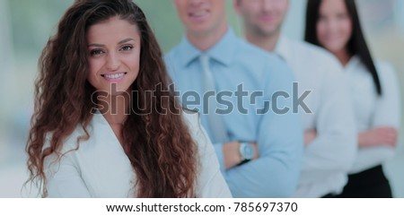 Elegant co-workers looking at camera during meeting in office #785697370