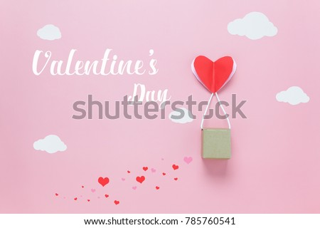 Table top view image of decoration valentine's day background concept.Text sign of season with paper cut balloon love on beautiful pink sky with cloud.Several objects on pink wallpaper.pastel tone.