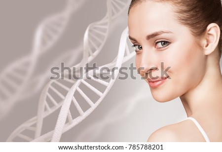 Portrait of sensual woman among DNA chains #785788201