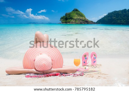 Lady sleep and relax on the beach in Thailand resort, this photo can use for Travel, relax, beach, summer, and Holiday concept #785795182