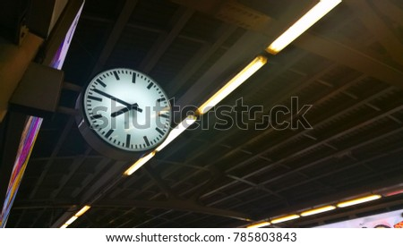 Round wall clock hanging on the wall  #785803843