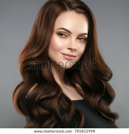 Woman beauty healthy skin and hairstyle, brunette with long hair over dark background female portrait. Studio shot. #785852998