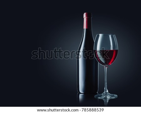 Wine bottle and glass with red wine on dark glossy background. #785888539