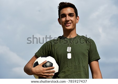 Athletic Hispanic Male Teen Soldier And Soccer #785927437