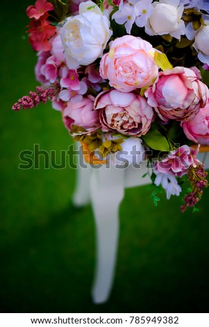luxury wedding. decor in nature, with fresh flowers of roses, peonies, chrysanthemums, eucalyptus. In the open air