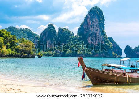Long tail boat on tropical Railay beach, Aonang, Krabi, Thailand #785976022