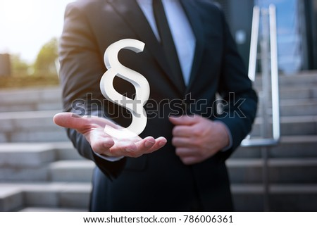 business man holding paragraph sign in his hand #786006361