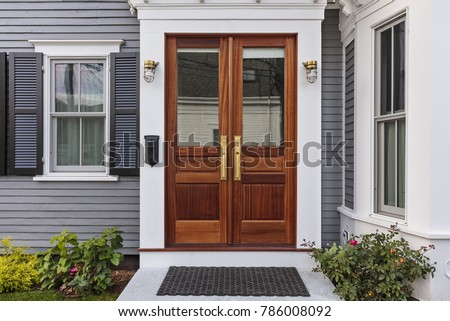 Front door, double brown front door with a secured front entrance Royalty-Free Stock Photo #786008092