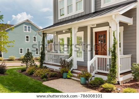 Exterior view of an upscale house with a really nice beautifully landscaped front yard #786008101