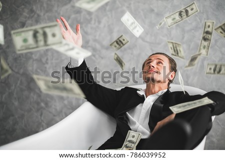 Business man, rich, millionaire, billionaire, with many banknote dollars money Royalty-Free Stock Photo #786039952