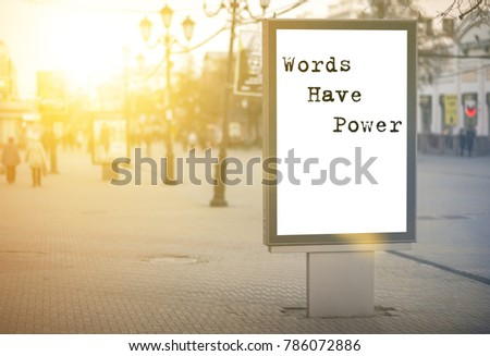words have power - words, phrase. on a white background billboard in the center of the city against sun rays #786072886