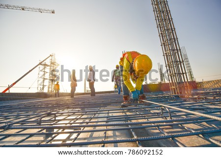 Construction workers fabricating steel reinforcement bar at the construction site Royalty-Free Stock Photo #786092152