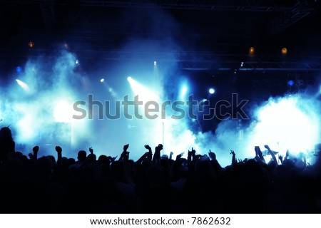 Cheering crowd at concert, musicians on the stage #7862632