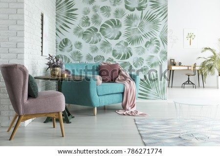 Bright flat with white brick wall and monstera leaves wallpaper in botanic living room Royalty-Free Stock Photo #786271774