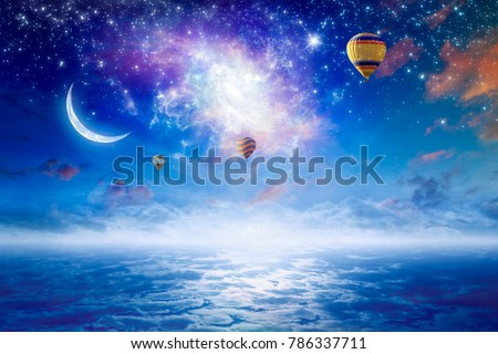 Tranquil heavenly picture - colorful hot air balloons flying in blue starry sky with bright stars, new moon and twisted galaxy. Elements of this image furnished by NASA