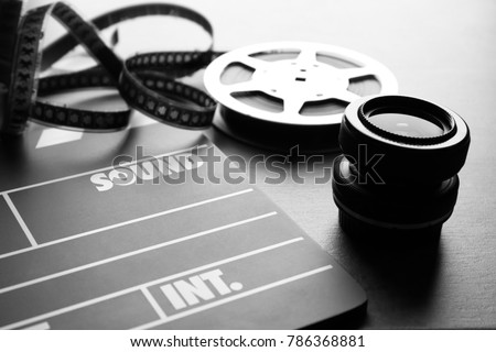 Movie clapper and lens on grey background, closeup #786368881