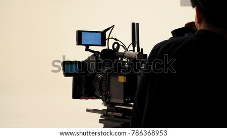 Behind the video shooting production crew team working and set of full hd camera equipment in studio. #786368953
