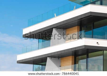 New apartment glass balcony terrace of modern architecture house by the sea #786440041