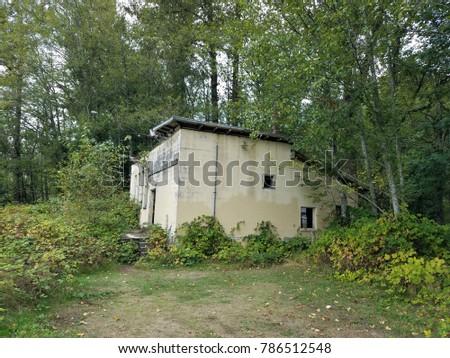 Abandoned concrete building #786512548